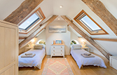 Attic bedroom with two single beds