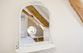 Rustic mirror in attic room